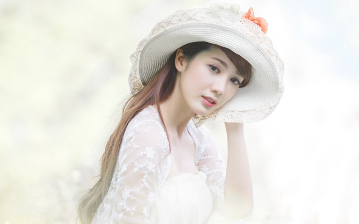 Asian Girl Wearing White Dress And White Hat