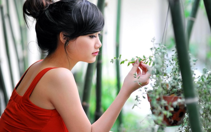 Beautiful Woman Looking At The Flowers Girl