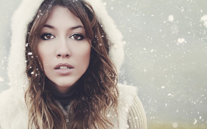 beautiful girl in winter with snowflakes