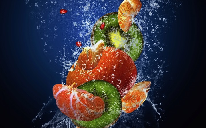 Fruit falling into water clear ripple fresh red orange