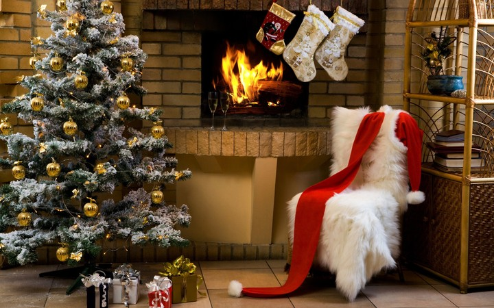 Gifs Under Christmas Tree Near Fireplace In Living Room