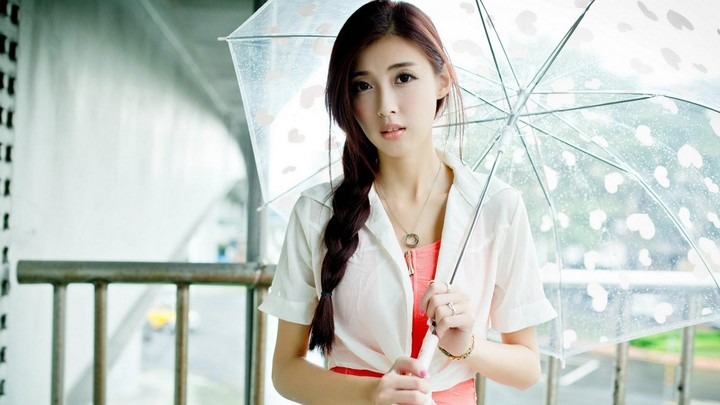 Young Woman With White Umbrella Close Up Under Summer Rain On Sunrise