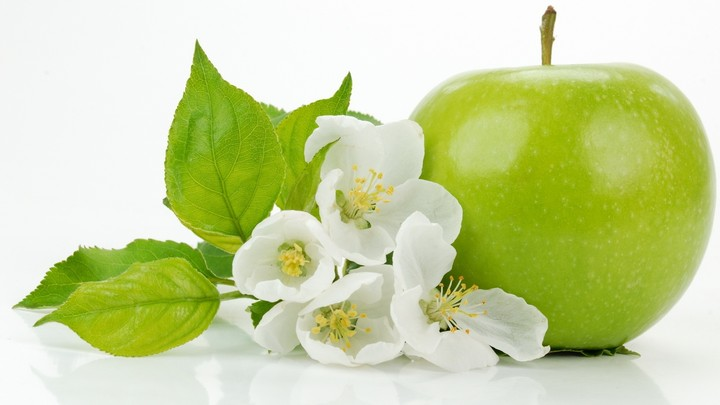 Green Apple With Apple Flowers Close Up