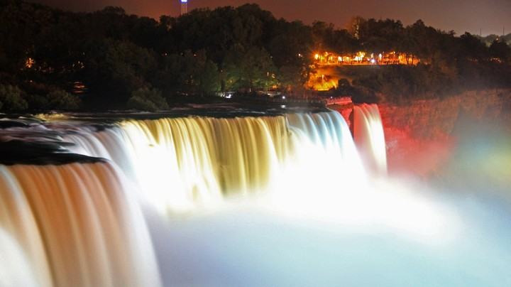 Illuminated American Falls, part of Niagara Falls, seen from the Prospect Point Park observation tower in Niagara Falls, New York